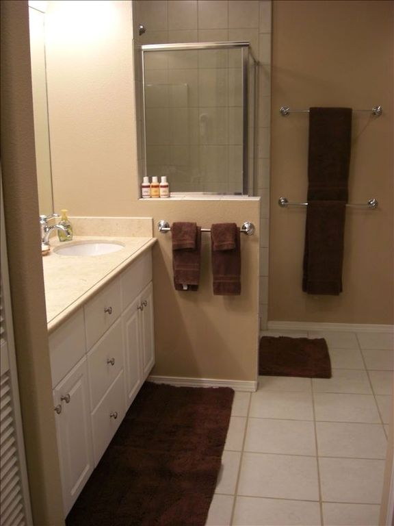 Master bathroom has both a SHOWER & a separate bath. Also,walk in closets too!