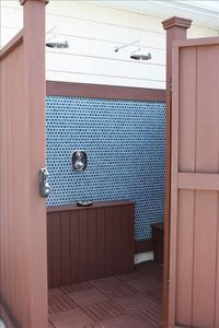 Custom outdoor Spa Shower.  Dual rainfall shower heads with hot and cold water