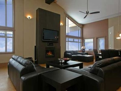 Huge lounge area with lots of comfy leather sofa seating around the fire and TV.