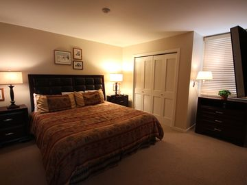Downstairs Bedroom with King bed, TV and private attached full bathroom.
