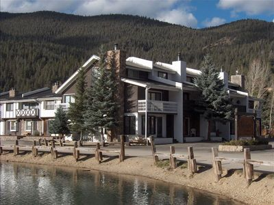 End unit with view of ski slopes across street, and also next to pond and stream