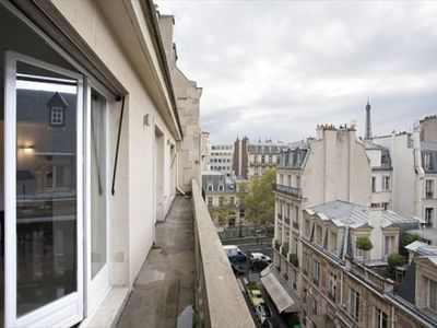 Wrap around balcony to entire property with Eiffel Tower view