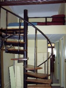 Looking south: spiral stairs to loft queen bed