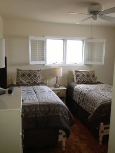 The second bedroom with two twin beds and flat screen TV.