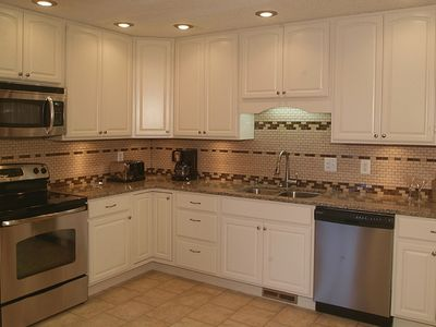 New updated expanded kitchen, new appliances, large refrigerator, granite,