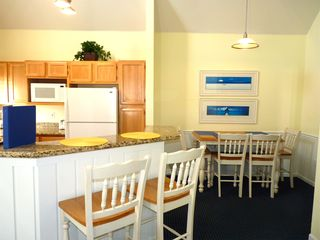 Runaway Beach Resort condo photo - Large Table for 4 plus Breakfast Bar seating for 2.