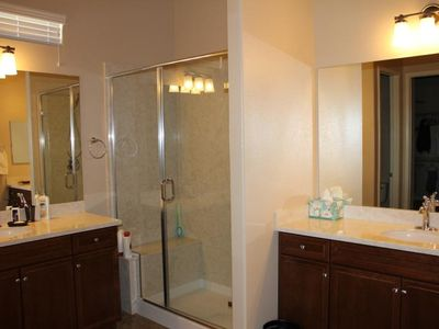 Master bath with Separate vanities, step in shower