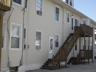 Side view of building. Steps to the 2nd floor condo. - Wildwood condo vacation rental photo
