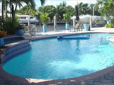 Relax in Heated Pool & Spa. Relax on the sun soaked Patio and Waterfront Dock