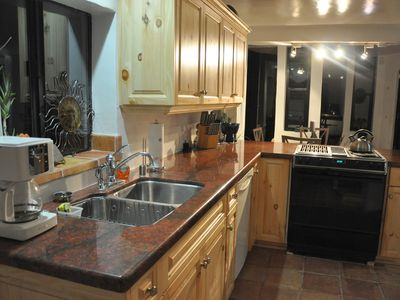 Kitchen.. natural pine cabinet and earthy granite countertops