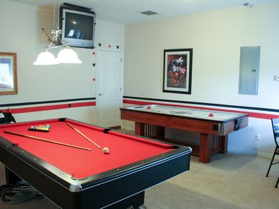 Game room has a 8' Pool Table, 7' Air Hockey Table and 32 in. TV
