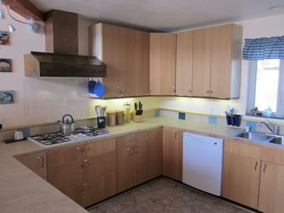 Gualala house rental - Kitchen - New ceramic counter tops, new floor, new copper bar - labelled storage