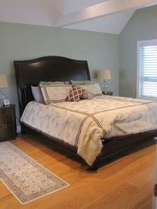 Second master suite has beautiful hardwoods, walk in closet and luxurious bath