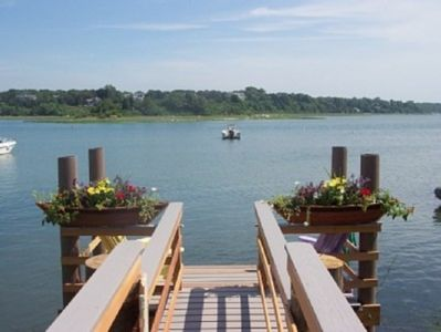 Our dock with flowers and Adirondack Chairs