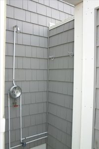 Take an outdoor shower after a day at the beach.