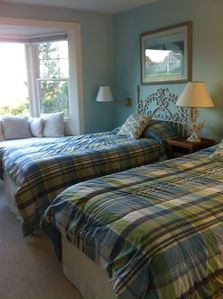twin beds blue room with bay window--perfect for reading.