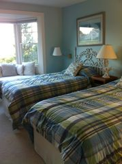 Chatham house photo - twin beds blue room with bay window--perfect for reading.