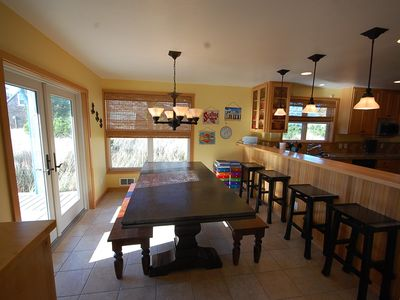 Full size dining room, bench style seating and bar seating