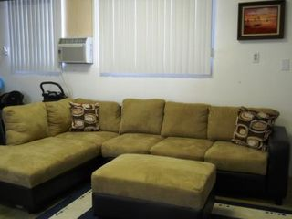 Anaheim house photo - Garage Entertainment has sectional sofa, air-condition, and 1080p projector.