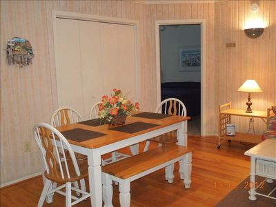 Dining area sits 6 comfortably, with an additional table for 4 more.