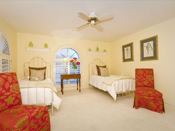 Bedroom with Two Twin Beds, Walk-In Closet and Armoire with Television