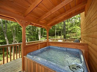 Back deck with covered hot tub overlooking the woods and total privacy