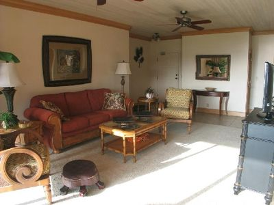 "Opposite enlarged kitchen- Living room in from lanai to entry . 38""TV & WI FI."