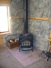 Estes Park cabin photo - Wood Stove in living room in large cabin (wood provided)