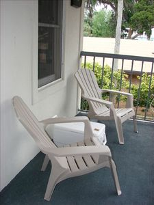 2 adirondack chairs so you can sit on the front balcony