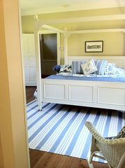 Gloucester estate photo - You'll find a a comfortable king bed in the master bedroom on the main level.