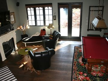 Lower level living area with pool table, fireplace, flat screen t.v. & wet bar.