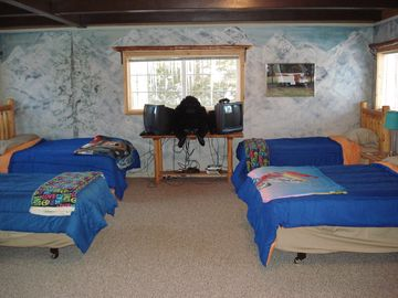 Huge bedroom with 2 full size beds and 2 single size beds