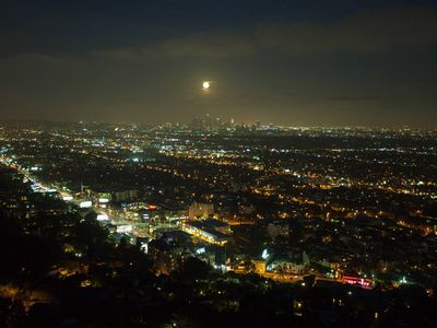 Full moon over L.A. from the balcony. Bright lights of the Sunset Strip below.