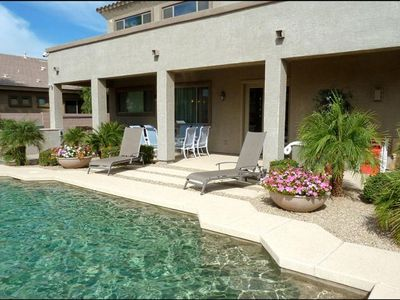 Swimming pool and patio with Jacuzzi and built-in BBQ grill