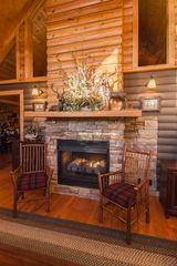 Pigeon Forge cabin photo - 2 way stone stacked fireplace great room-living room, cathedral ceilings