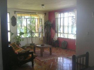 Bacalar house photo - Living room with porch outside. Sculpture replaced with electric massage chair.