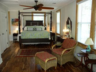 Savannah cottage photo - Oversized master bedroom with sitting area and Flat Screen LED TV