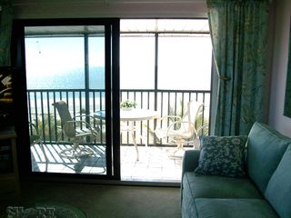 Sanibel Island condo photo - Look out here at the green gulf through 4 side windows and glass door.