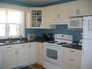 Augustine Cove cottage photo - Fully equipped kitchen includes a view.
