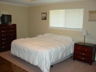 Coldspring house photo - Masterbedroom #1 has 3 different bed coverings, white, sage, and sage and cream