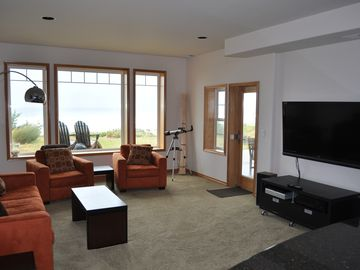 Lower living area with 55 inch HD TV and patio access