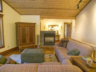 Great room and tv with views of the maple forest and Lake Superior