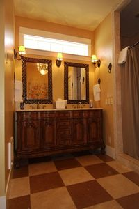 Sumptuous Master Bath with Travertine Floors, Shower, and Luxurious Surroundings