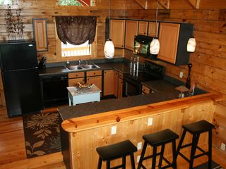 Pigeon Forge cabin photo - Gourmet kitchen is fully stocked for wonderful cooking and a Keurig coffee maker