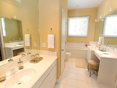 Master bath features a garden jetted tub with a separate shower & commode room!