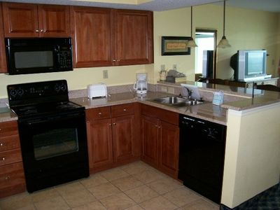 Open Plan Kitchen with Granite Counter Top