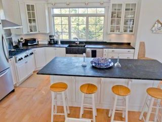 Katama house photo - Chef's Kitchen Features Large Granite Breakfast Bar/Prep Island For Easy Vacation Entertaining