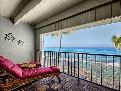 Dual loungers on the teak and ironwood lanai with the ocean crashing below