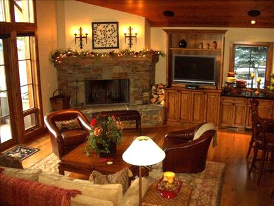 Vaulted ceilings and Montana Bronze stone fireplace in living area