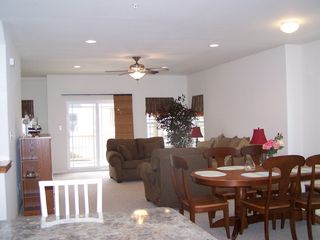 Wildwood townhome photo - comfortable dining and living room area w/balcony